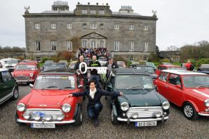 More than fifty Mini enthusiasts arrived at Westport  on Saturday 25th February for the launch of the International Mini meeting at Westport House from 26th to the 28th May, Biddy Hughes Marketing Manager Westport House is pictured withJoe Conboy site manager, Stuart Thornton (ticket sales) and Bernard  Joyce with the drivers and supporters on the steps. Picture; Frank Dolan.