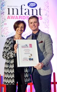 Biddy receiving the Best Family Holiday Destination from Brian (off the telly!) at the Maternity and Infant Awards, held at the Doubletree Hilton Hotel, Dublin. October 2015.