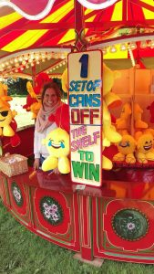 Tracey is ready to test your ability to knock three cans off the shelf - for an emoticon teddy!