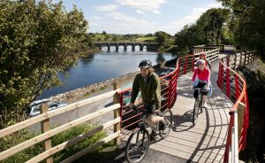 Westport to Achill Great Western Greenway. Cyclists enjoy the beautiful surrounds of the landscape at the Burrishoole Bridge section of the Greenway. Pic: Michael Mc Laughlin